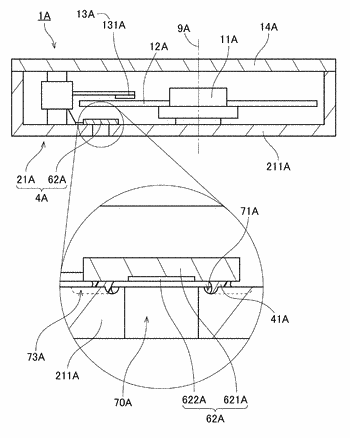 Disk drive base unit with communicating groove extending outside outer circumferential portion of connector
