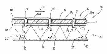 Arrangement comprising a visible seam and a lighting apparatus, use thereof, and method for producing ...