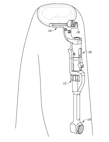Assembly and system including a tibial cut guide